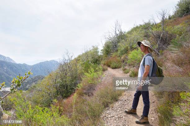 senior man backpacker looking at the view in angeles national forest, california - stellalevi stock pictures, royalty-free photos & images