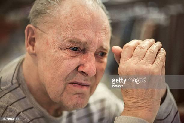 Senior man battling with Alzheimer