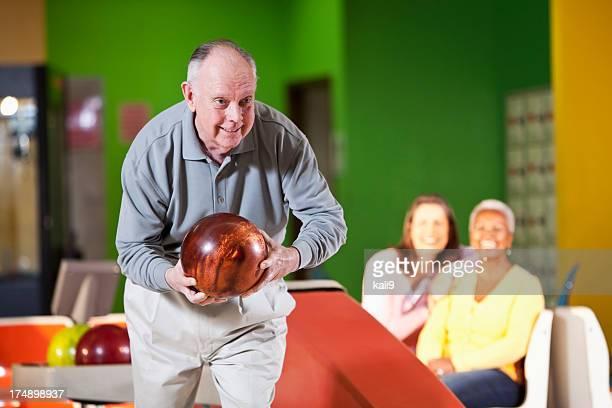 Senior man bowling