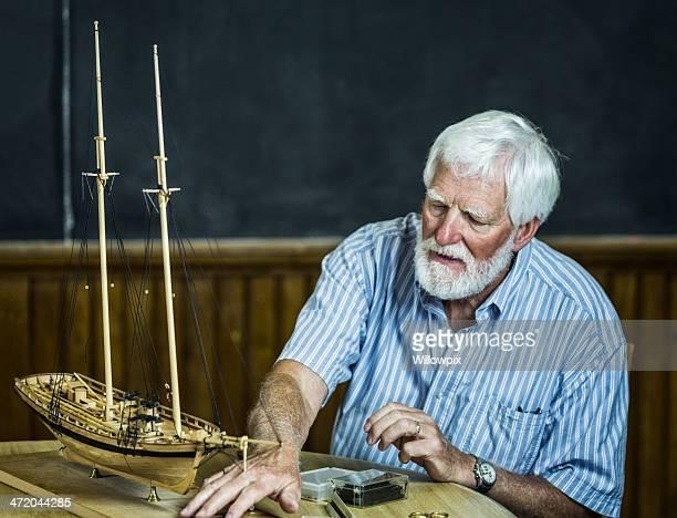 Senior Man Building Model Sailboat