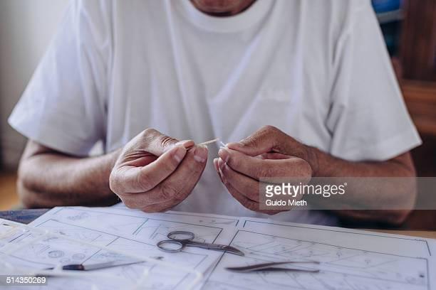 Senior Man building scale modell.