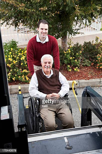 senior man by minibus with wheelchair lift - assistive technology stock photos and pictures