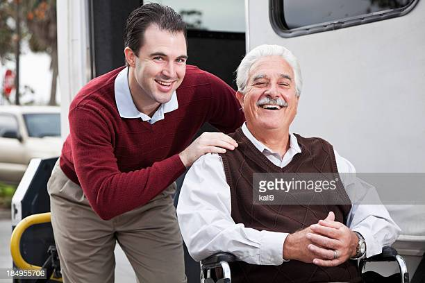 senior man by minibus with wheelchair lift - disabled access stock photos and pictures