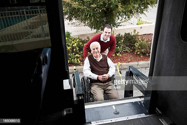 senior man by minibus with wheelchair lift - accessibility stock pictures, royalty-free photos & images