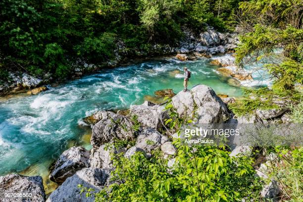 senior man by the soca river - slovenia stock pictures, royalty-free photos & images