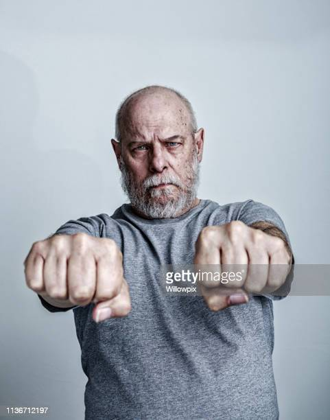senior man cancer chemotherapy patient defiant hands and fists - colorectal cancer stock pictures, royalty-free photos & images
