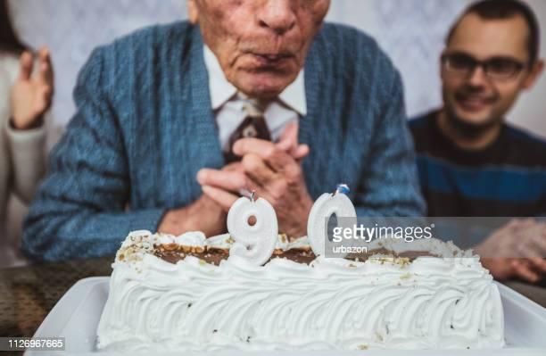senior man celebrates birthday - origins stock pictures, royalty-free photos & images