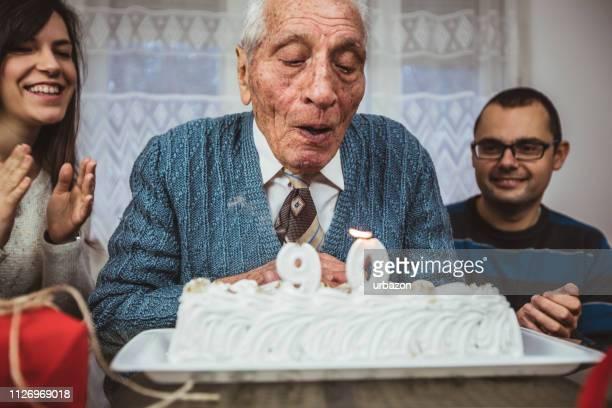 senior man celebrates birthday - 90 plus years stock pictures, royalty-free photos & images