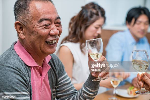 Senior man celebrating a special occasion with the family