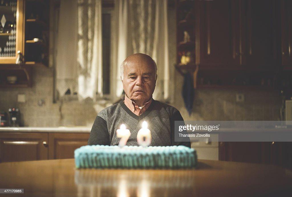 Senior man celebrating alone his birthday : Stock Photo