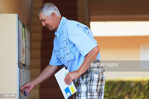 senior man checking his mailbox - domestic mailbox stock pictures, royalty-free photos & images