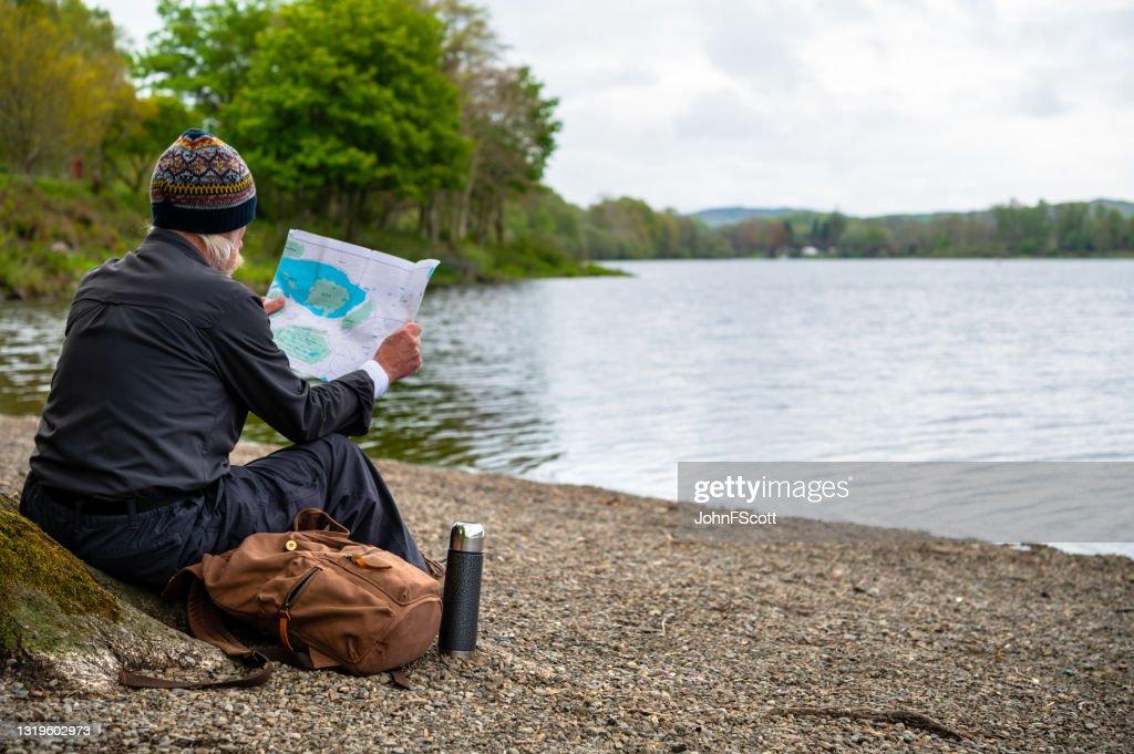 Senior man checking his map : Stock Photo