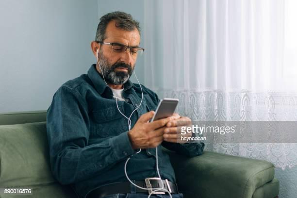 Senior man checking smart phone