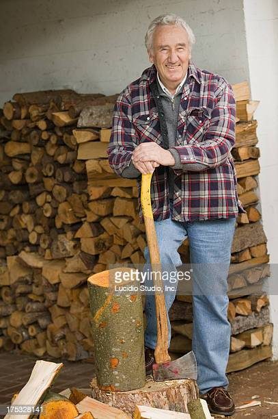 Senior man chopping wood