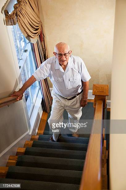 Senior man climbing stairs