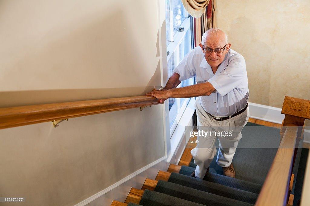 Senior man climbing stairs : Stock Photo