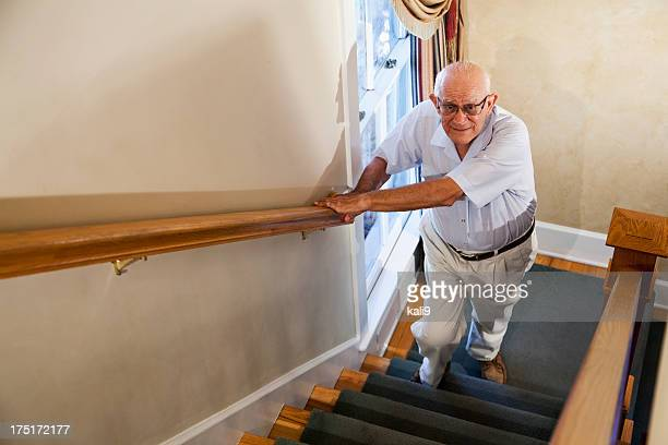 senior man climbing stairs - stairs stock photos and pictures