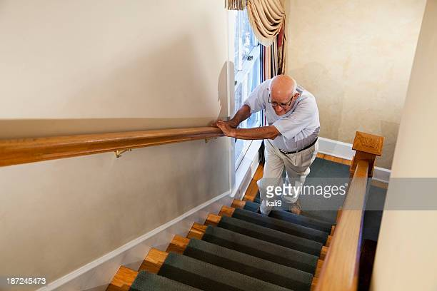 senior man climbing stairs - struggle stock pictures, royalty-free photos & images