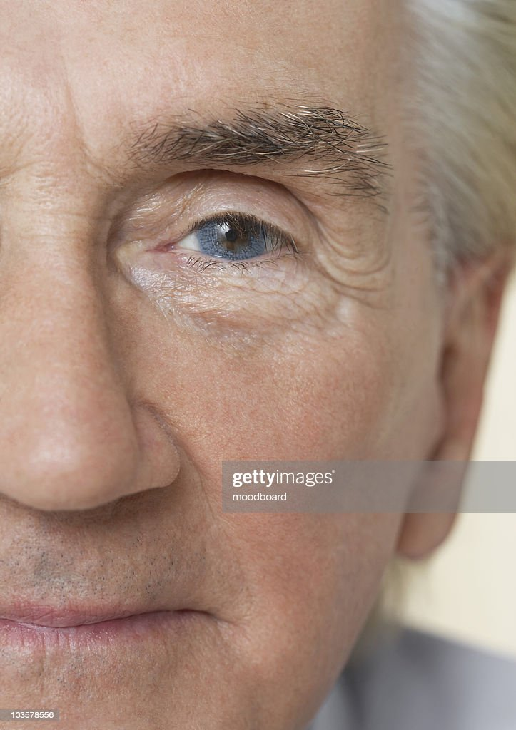 Senior Man, close up of half of face : Stock Photo