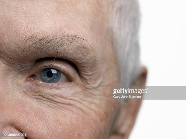 senior man, close-up of eye - norman elder stock photos and pictures