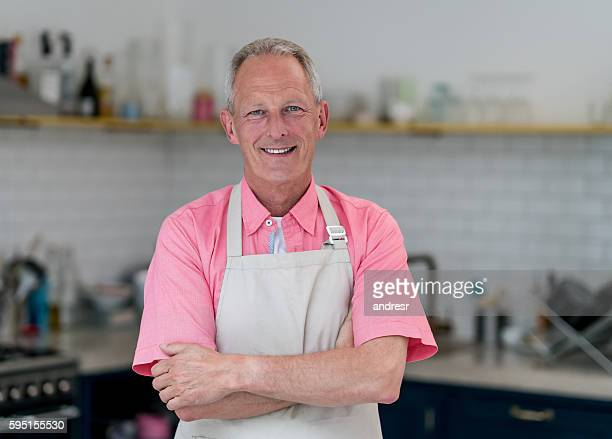 Senior man cooking at home
