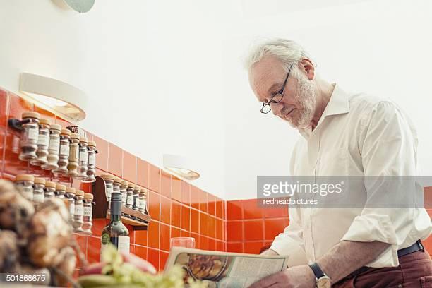 Senior man cooking in kitchen
