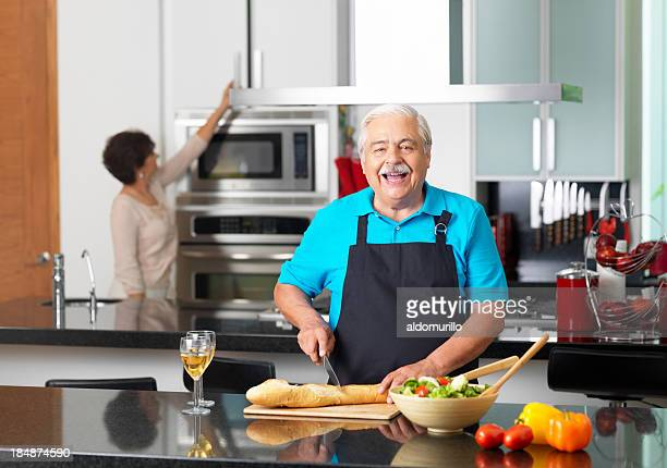 Senior man cooking in the kitchen