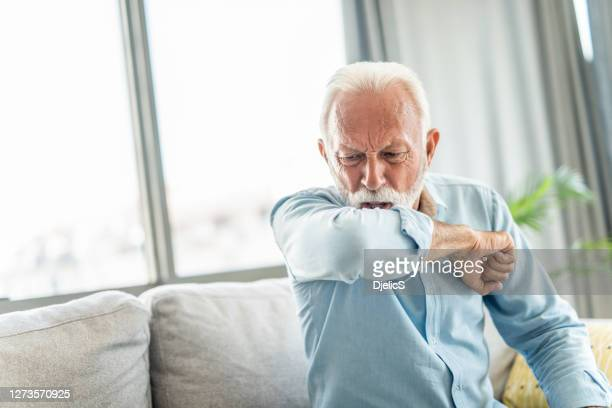 senior man coughing. - cough stock pictures, royalty-free photos & images