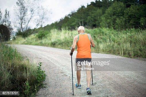 Senior man cross country walking