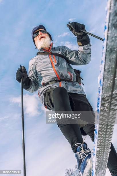 senior man cross-country skiing - ski pole stock pictures, royalty-free photos & images