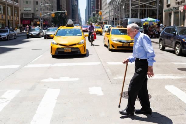 Senior man crossing the road in New York City