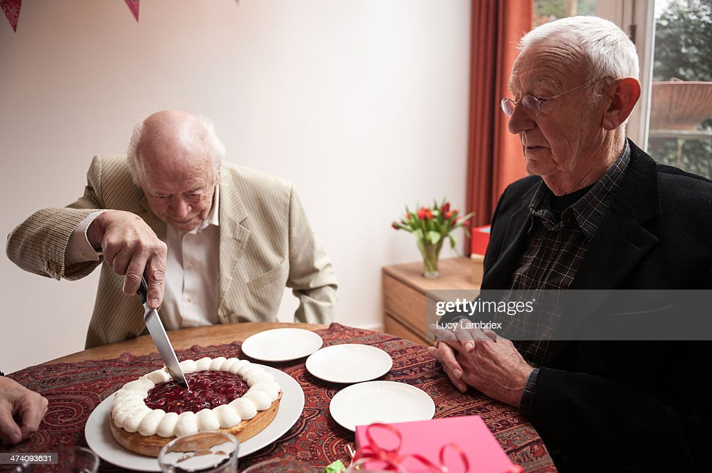 Senior Man Cutting His Birthday Cake Stock Photo Getty Images