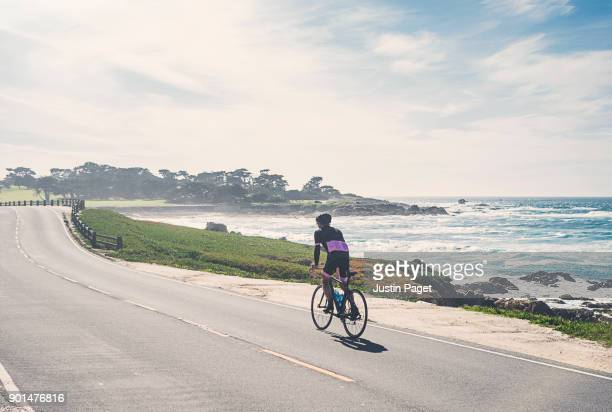 Senior man cycling along Pacific coastline