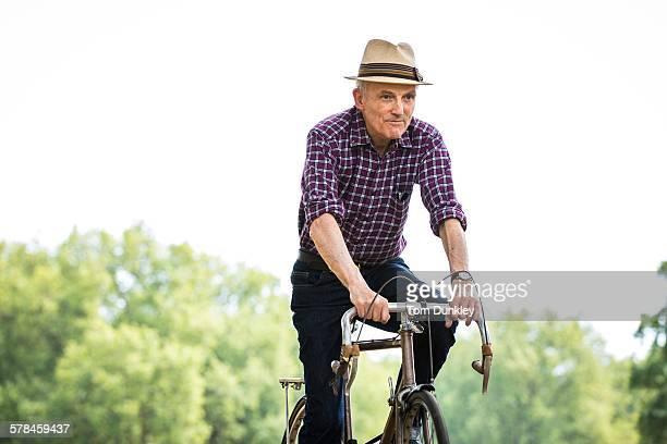 Senior man cycling in park