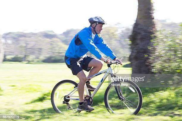 Senior man cycling outdoors