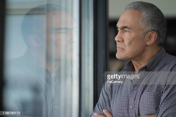 senior man deep in reflection stock photo - 50 59 years stock pictures, royalty-free photos & images