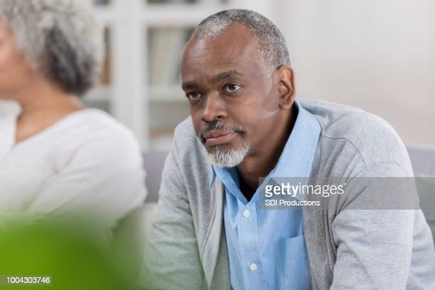 senior man disagrees with wife at home - patience stock pictures, royalty-free photos & images