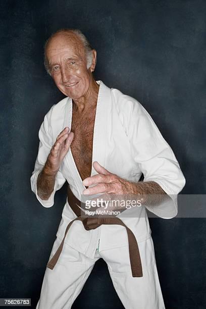senior man doing karate pose, three quarter length, portrait - three quarter length ストックフォトと画像