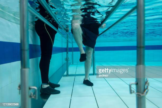 senior man doing physical therapy in the water - recovery stock pictures, royalty-free photos & images