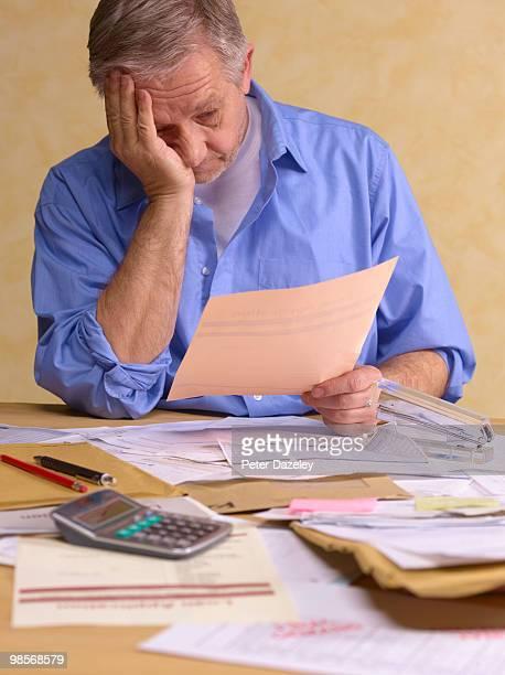 Senior man doing tax return