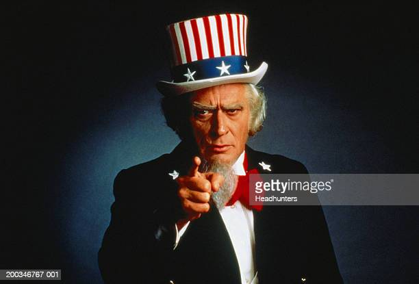Senior man dressed as 'Uncle Sam' pointing finger
