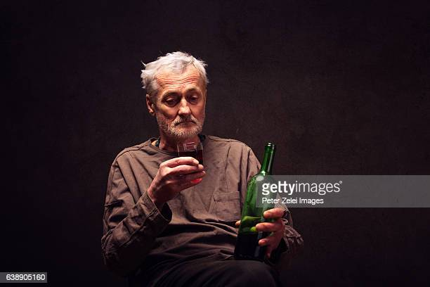 senior man drinking wine