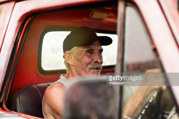 senior man driving an old pick up - pick up truck stock pictures, royalty-free photos & images