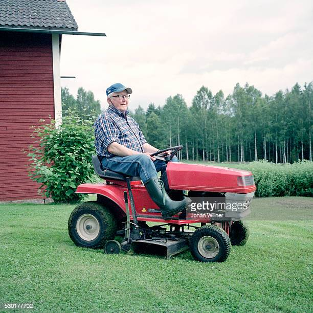 senior man driving lawn mower - lawn mower stock pictures, royalty-free photos & images