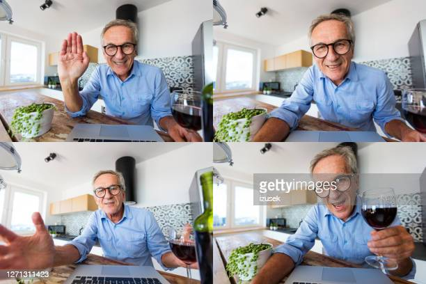 senior man during video call - happy hour stock pictures, royalty-free photos & images
