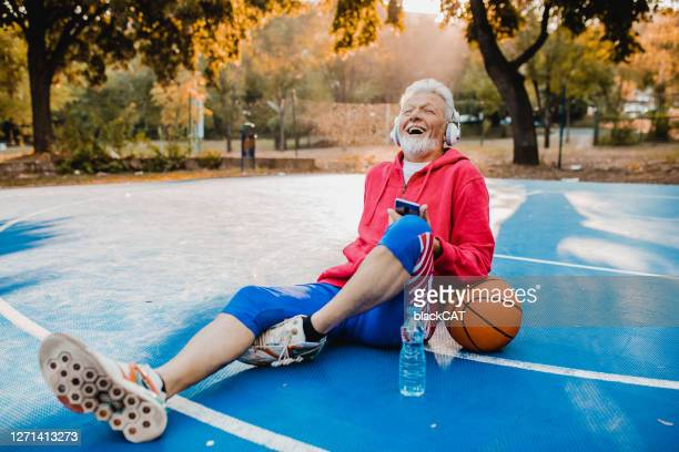 senior man enjoying on the basketball - sports event stock pictures, royalty-free photos & images