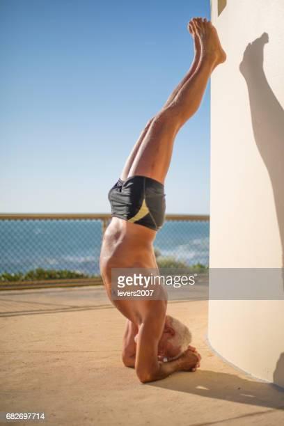 Senior man exercising at the beach