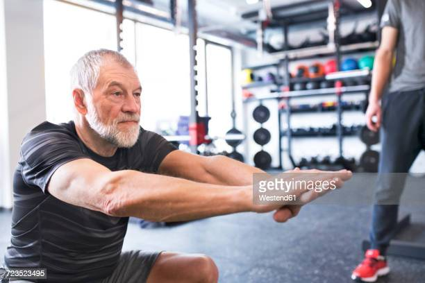 senior man exercising in gym - trainold stock pictures, royalty-free photos & images