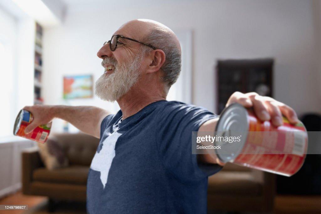 Senior man exercising in lockdown : Stock Photo