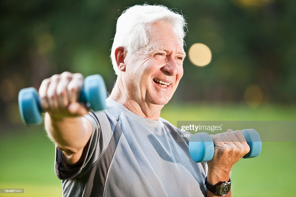 Senior man exercising outdoors : Stock Photo